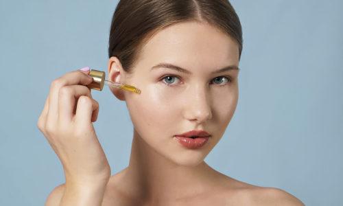 woman applying face oil