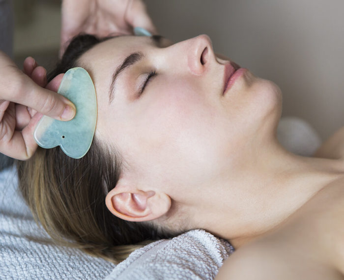 woman gua sha facial